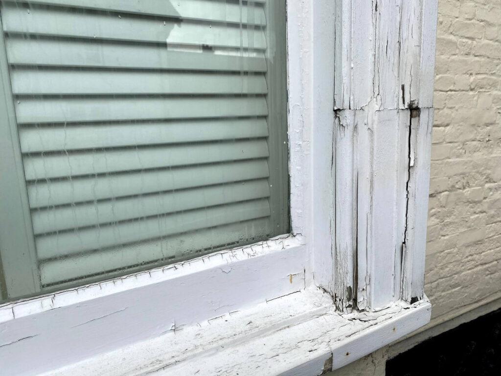 Peeling paint and rotten wood on sash windows